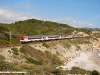 Un doppio complesso di Media Distancia di RENFE transita lungo la linea Barcelona-Vilanova, in prossimità della costa mediterranea. (Sitges, 05/04/2010; foto Marco Stellini / TuttoTreno)