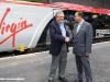 """Tony Collins, Virgin Trains CEO, e Paul Robinson, Alstom Transport MD, durante la cerimonia in cui il Pendolino 390 004 della Virgin Trains è stato rinominato """"Pendolino Alstom"""" durante una breve cerimonia a London Euston. (16/09/2010; foto Alstom / tuttoTreno)"""