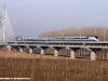 Il treno diagnostico ETR 500 Y1 di RFI mentre sta per imboccare il ponte sul fiume Po nella linea AVAC Milano-Bologna. (Piacenza, 09/12/2008; foto Walter Bonmartini / tuttoTreno)