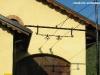 Il pezzo di linea aerea trifase ricostruito a ridosso del magazzino merci della stazione di Nucetto dove troverà posto il Museo che verrà inaugurato domenica 9 ottobre. (30/09/2011; foto Michele Cerutti / tuttoTreno)